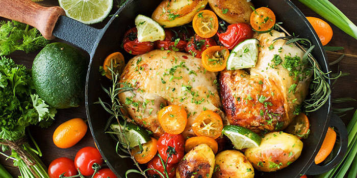 Roast Chicken Quarters with Potatoes and Tomatoes