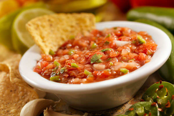 Jarred tomato salsa with chips