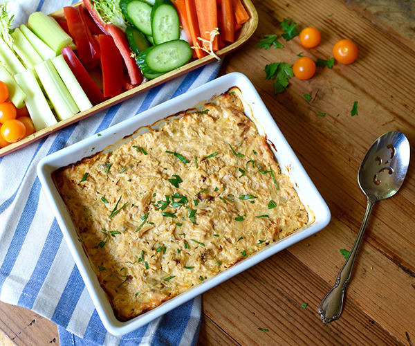 To make this healthier Buffalo Chicken Dip, we've combined cayenne pepper hot sauce with two creamy cheeses, and yummy blue cheese crumbles.