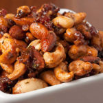 These Spiced Nuts are a tasty light snack made with cumin, cinnamon, and cayenne spiced nuts are sweetened with a touch of honey.
