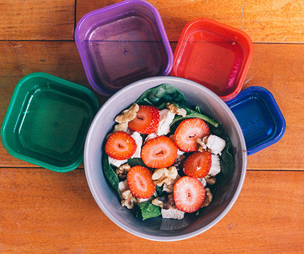 spinach salad with strawberries, chicken, and walnuts
