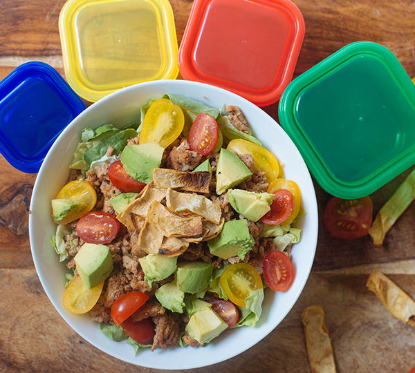 With seasoned ground turkey, this Healthier Taco Salad Recipe is loaded with crisp lettuce, juicy tomatoes, diced avocado, and crunchy tortilla strips.