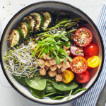 This Vegan Buddha Bowl is no sad desk lunch, this hearty bowl features whole grains, fresh and roasted veggies, hemp seeds and delicate sprouts.
