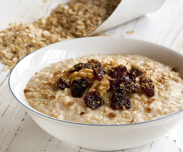 Overloaded oatmeal breakfast recipe with raisins and walnuts.