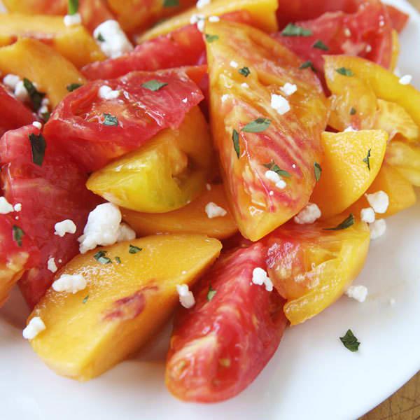 sliced peach and heirloom tomato salad