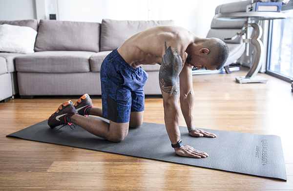 3 of the Best Trap Exercises for Muscle and Power cat stretch