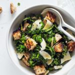 This Healthier Caesar Salad features savory Parmesan cheese, whole wheat garlic croutons, and a tangy lemon garlic dressing.
