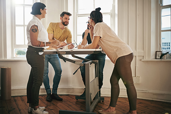 People working at standing desk