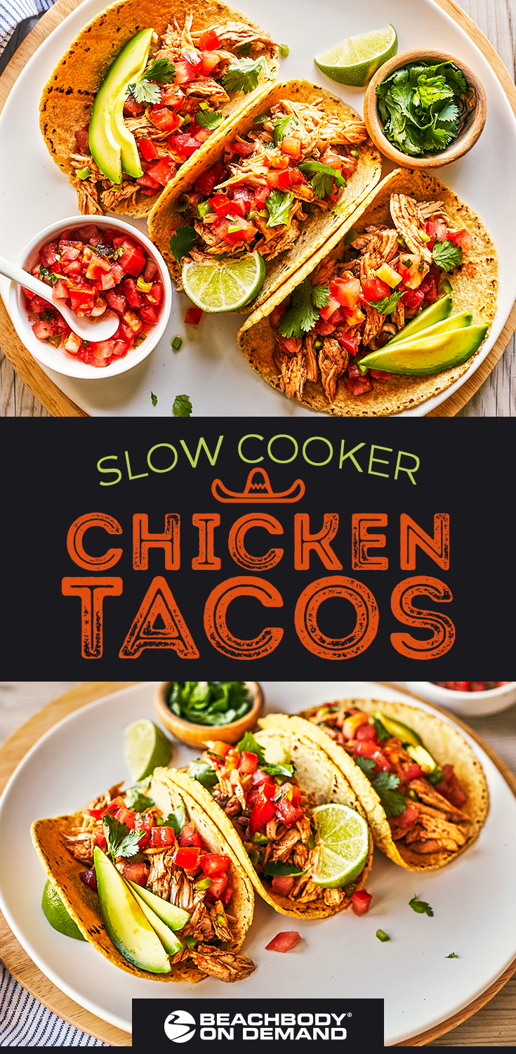 Bring the flavor of your favorite Mexican restaurant home with this healthy recipe for Slow Cooker Chicken Tacos with fresh tomatoes, lime, cilantro and avocado.