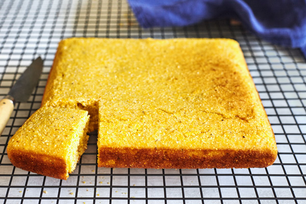 Classic cornbread fresh from the oven, cooling on a rack.