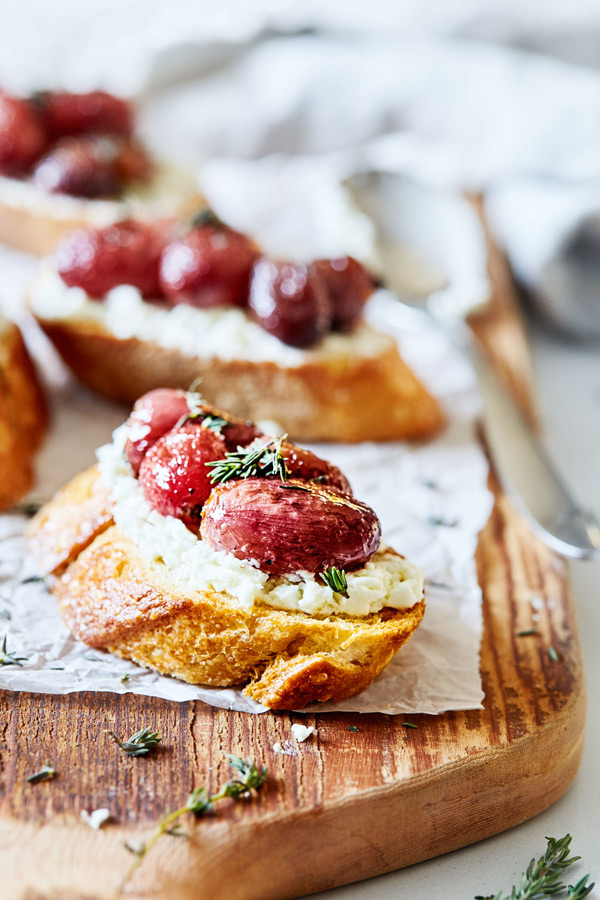 Looking for an easy crostini recipe? This Roasted Grape and Goat Cheese Crostini holiday appetizer is beautiful and uses only a handful of ingredients.