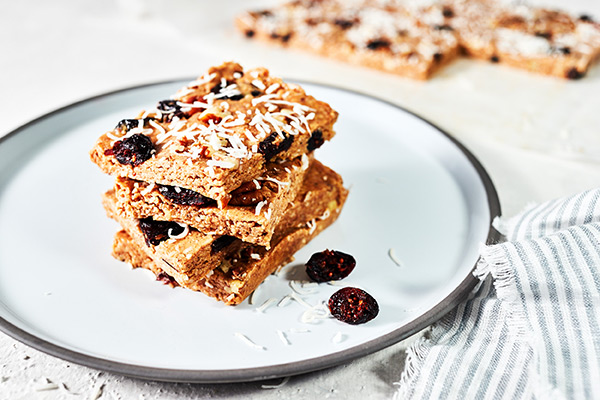 These Cranberry Bliss Bars taste just like the original only these are healthier, with smooth almond butter, shredded coconut, and pumpkin pie spice.