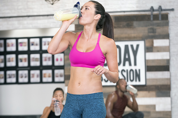 Autumn Calabrese drinking Beachbody Performance supplement