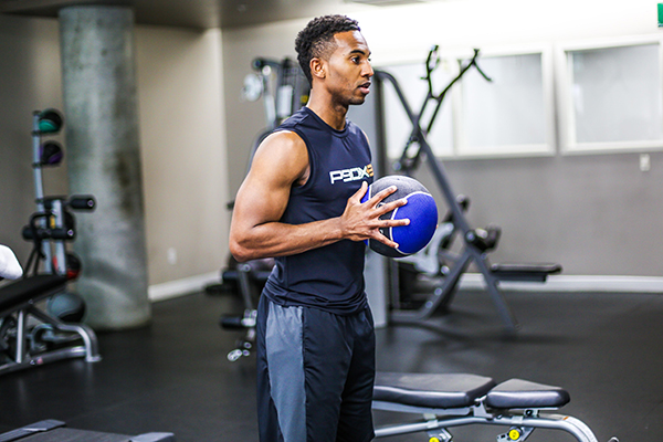 Man working out with a medicine ball