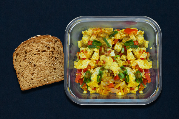Pre-workout meal for 80 Day Obsession Vegan tofu scramble with peppers, onions, and green onions with a piece of toast.