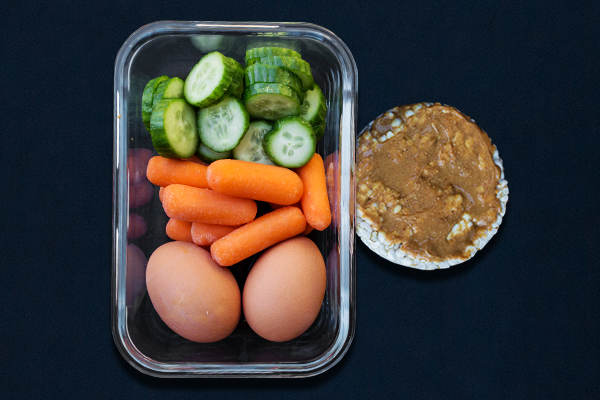 Pre-workout meals for 80 Day Obsession, pre-workout nutrition, pre-workout snacks, carrots, cucumber slices, rice cakes, hard-boiled eggs