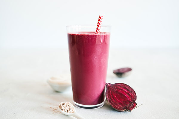 This decadent Red Velvet Smoothie features creamy Chocolate Shakeology, tangy balsamic vinegar, and fresh beet juice for that classic crimson hue.