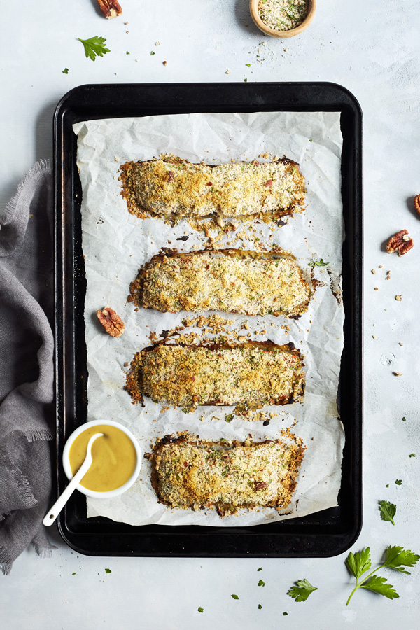 For an easy weeknight meal that's bursting with flavor try this Baked Salmon with Dijon featuring whole wheat bread crumbs, Dijon mustard, and raw honey.