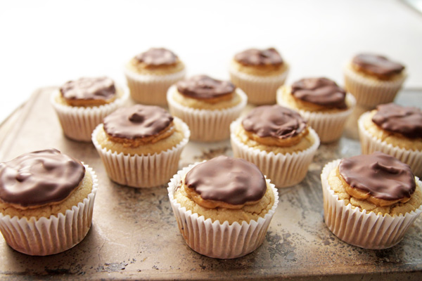 These healthier double Peanut Butter Cupcakes are ideal for your next party, featuring gooey bitter sweet chocolate chunks and all natural peanut butter.