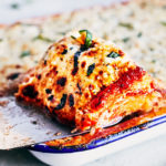 This sinfully delicious Spaghetti Squash Lasagna is made with all-natural marinara, part-skim ricotta cheese, and healthy spaghetti squash.