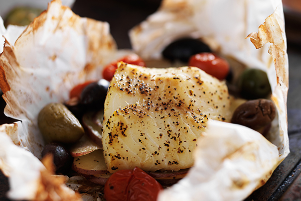 Baked fish in parchment paper