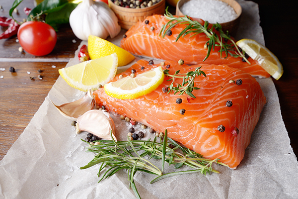 Salmon, spices in parchment paper