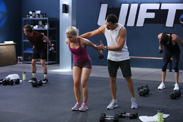 Woman lifting weights with LIIFT4