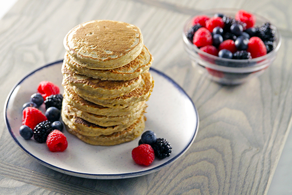 stack of pancakes and fruit on plate