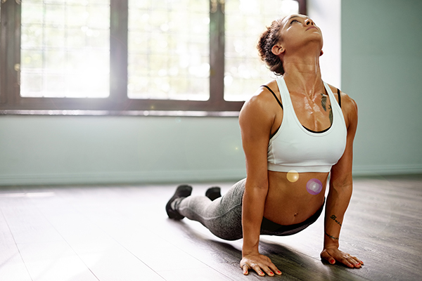 Woman sweating while doing yoga