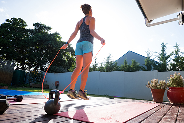 How to jump rope: Woman jumping rope on patio