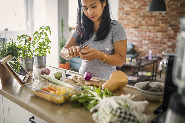 Woman at home making healthy meal