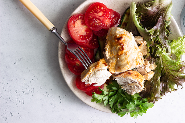 Chicken breast with salad, tomatoes