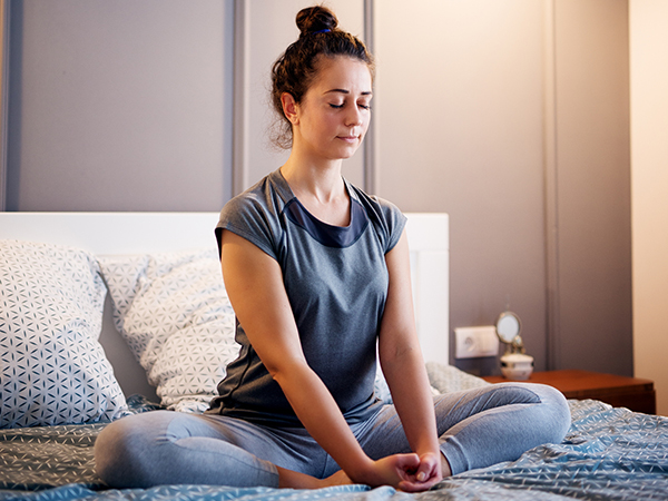 Woman seated doing breathing exercises