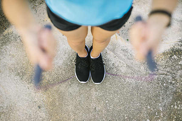 Woman holding jump rope in hands