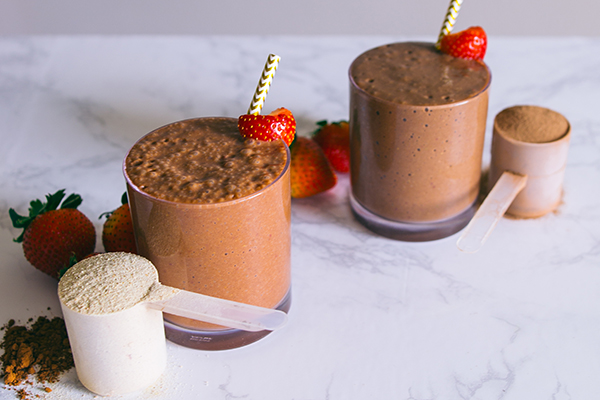 Two Shakeology shakes with scoops