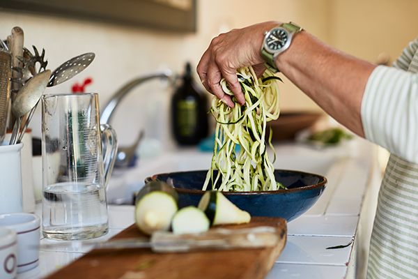 Woman making zucchini noodles