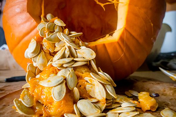 Pumpkin seeds inside a pumpkin
