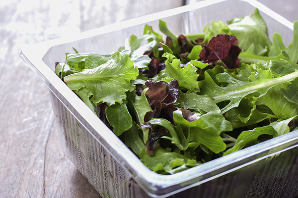 Greens in a plastic container