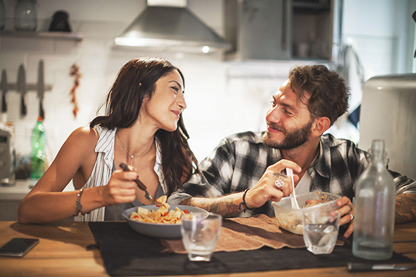 Couple eating and laughing together