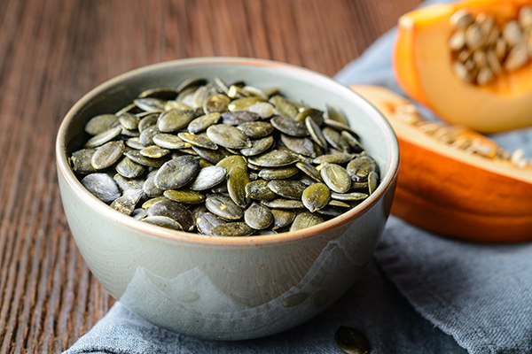Pumpkin seeds in ceramic bowl