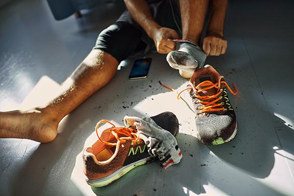 Man taking socks off after a run