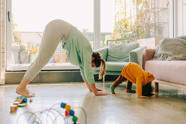 Photo of mom and baby boy doing yoga together