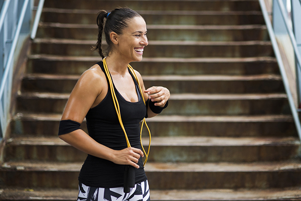 Woman smiling after jump rope workout