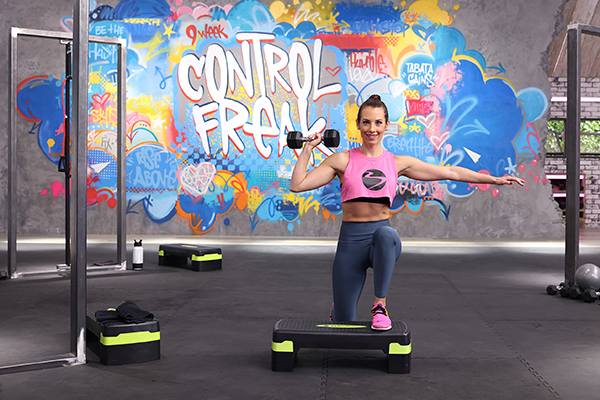 Autumn Calabrese using an aerobic step in a 9 Week Control Freak workout