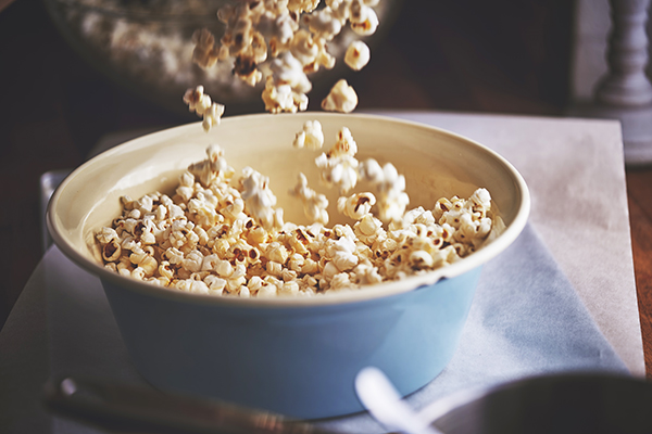 Popcorn pouring into a bowl