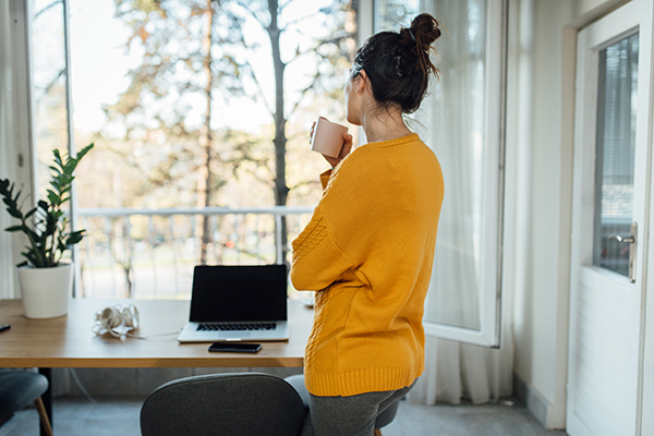 Woman taking a break from working at home