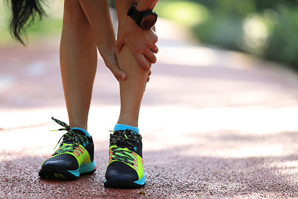 Runner gripping painful shin