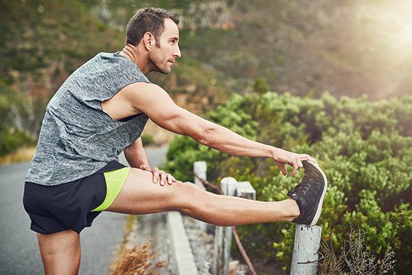 Man stretching leg after a run