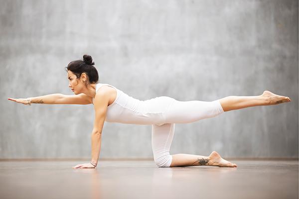 Woman doing bird dog exercise