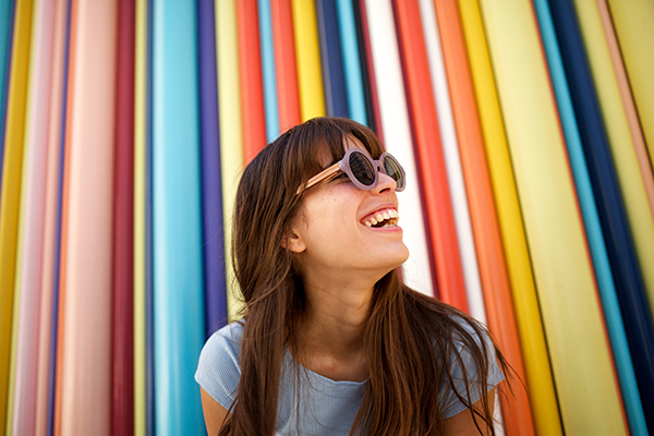Close up of cheerful young woman laughing.